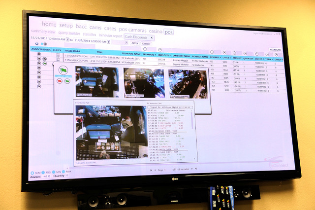 A video monitor displays a transaction along with the corresponding pictures from a video recording in the Las Vegas office of eConnect President and CEO Henry Valentino on Monday, Nov. 24, 2014.  ...