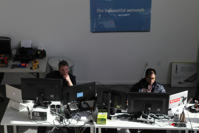 The Influential Network employees Nathan Sculli, left, software architect, and Jason Miguel, software engineer, work at their office in Las Vegas Thursday, Nov. 20, 2014. The Influential Network i ...