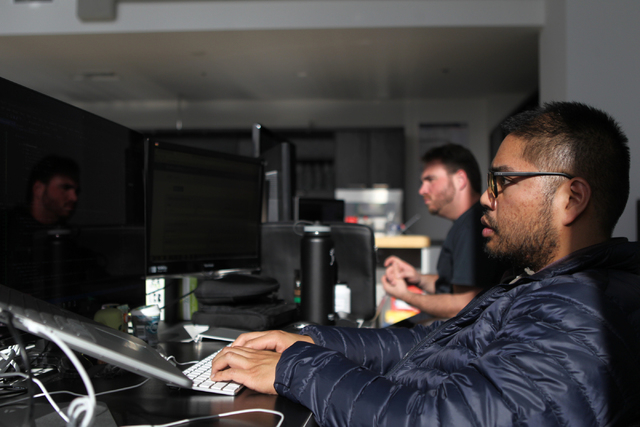 The Influential Network employee Jason Miguel, a software engineer, works at his office in Las Vegas Thursday, Nov. 20, 2014. The Influential Network is a social media marketing company that promo ...