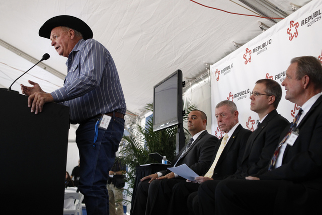 Clark County Commissioner Tom Collins, from left, speaks during the groundbreaking ceremony for the new Republic Services Southern Nevada Recycling Complex with Republic Services employees Len Chr ...