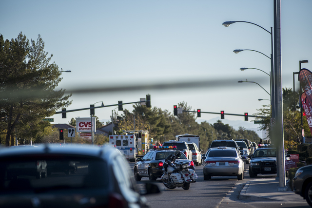 Las Vegas Police surround a person suspected of a string of robberies after officers stopped the suspect's vehicle shortly after 5 a.m. from the corner of Desert Inn and Fort Apache in Las Vegas o ...