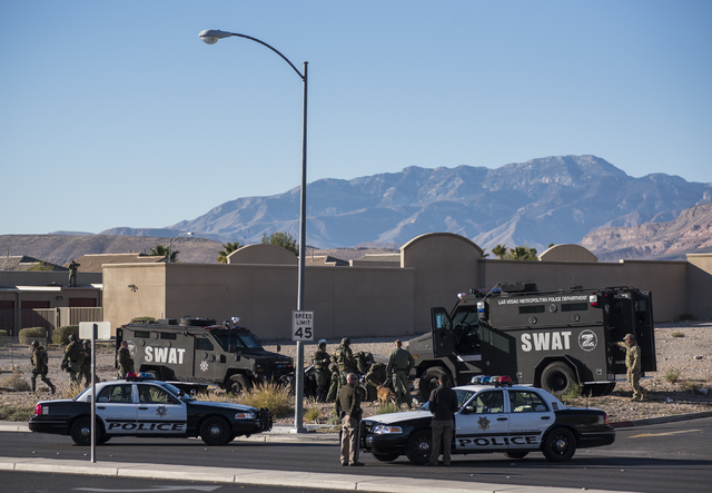 Las Vegas SWAT secures the area around Desert Inn and Fort Apache where officers have surrounded a person suspected of a string of robberies after officers stopped the suspect's vehicle shortly af ...