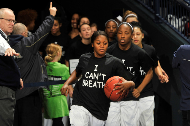 """Notre Dame players wears an """"I Can't Breathe"""" shirts during warm-ups before an NCAA college basketball game against Michigan,  Saturday, Dec. 13, 2014 in South Bend, Ind.  (AP Photo/Joe  ..."""