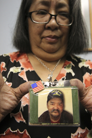 Johnnette Fafard, widow of Army Sgt. Raymond Fafard, shows a photo of her husband before an award ceremony honoring him at the Las Vegas office of Rep. Dina Titus Tuesday, Sep. 3, 2013. Fafard die ...