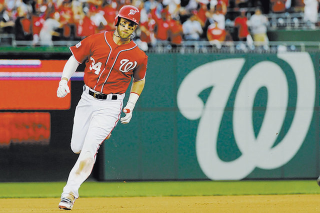 Washington Nationals left fielder Bryce Harper rounds the bases after hitting a solo home run against the San Francisco Giants in game one of the 2014 NLDS playoff baseball game, Oct 3, 2014. Harp ...