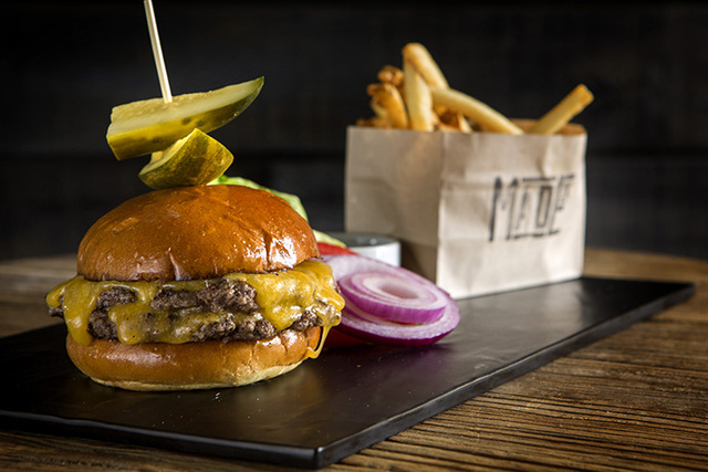 A Double Stack Burger Meister as seen at  Made L.V. in the Tivoli Village. The burger is Niman Ranch Beef, cheddar cheese, house-made steak sauce and french fries. (Jeff Scheid/Las Vegas Review-Jo ...