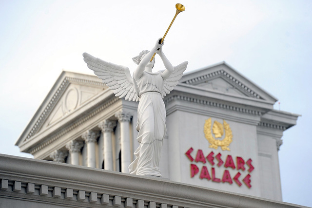A statue on display is seen in front of Caesars Palace hotel-casino on Thursday, Dec. 11, 2014, in Las Vegas. (David Becker/Las Vegas Review-Journal)