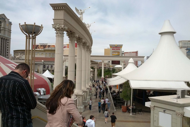 Pedestrians walk toward Caesars Palace in Las Vegas on March 27, 2014. On Monday, Nov. 10, Caesars said it lost $908.1 million in the third quarter. (Las Vegas Review-Journal file)