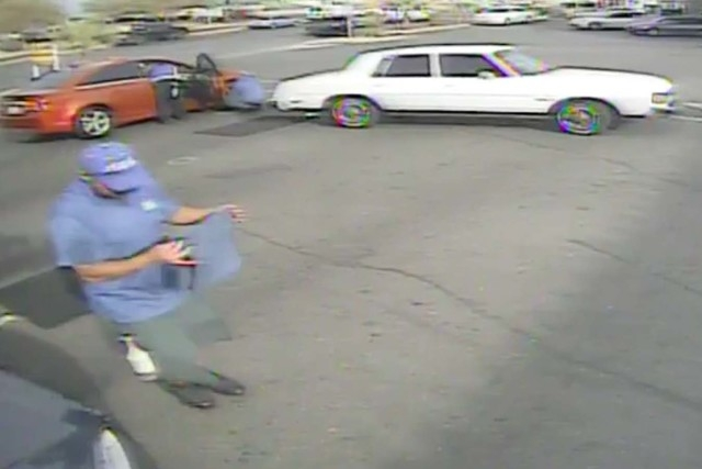 This image from a YouTube video shows a white car backing up in a car wash parking lot just before a man was hit and injured. (Courtesy, YouTube)