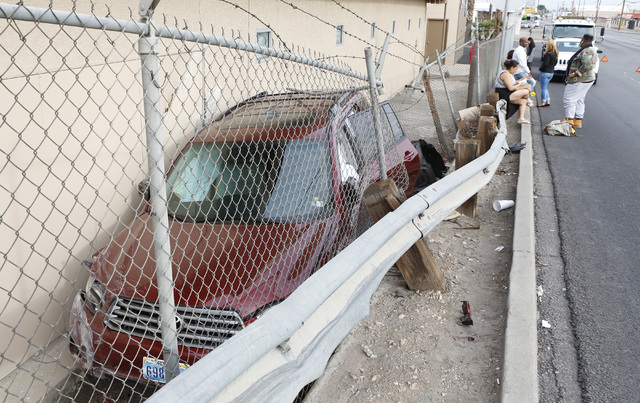An SUV jumped the curb and guard rail and crashed into the back of the building of Showtime Tours, 1500 S. Industrial Road on Thursday Dec. 11, 2014. The driver of the SUV said she was rear-ended  ...