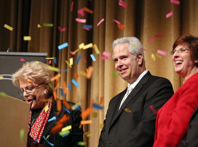 Confetti falls shortly after Las Vegas Mayor Carolyn Goodman, left, sworn in Bob Brown, center, as Chairman of the Las Vegas Metro Chamber of Commerce during the Las Vegas Metro Chamber Installati ...