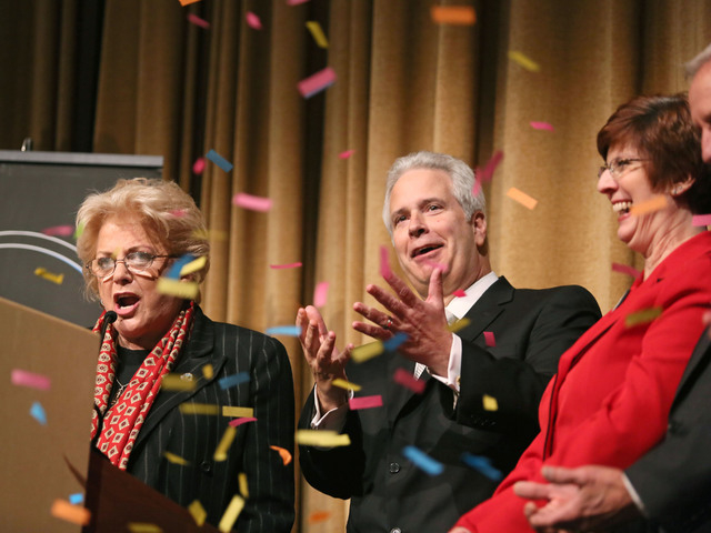 Bob Brown, center, reacts to confetti falling shortly after being sworn in as Chairman of the Las Vegas Metro Chamber of Commerce by Las Vegas Mayor Carolyn Goodman, left, during the Las Vegas Met ...
