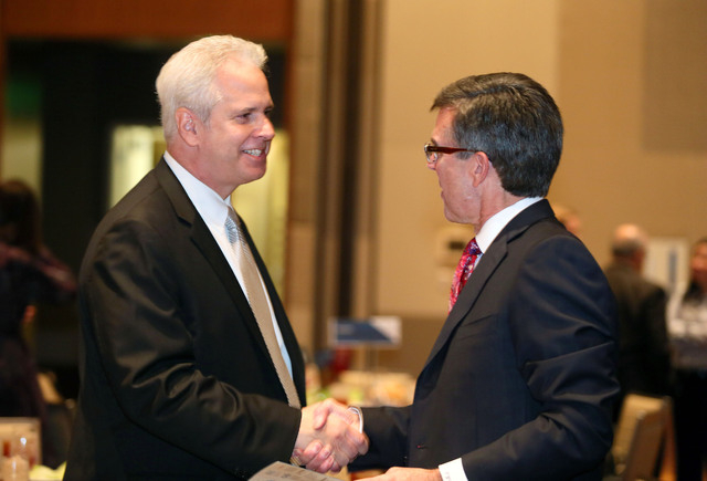 Bob Brown, left, president of Opportunity Village, shakes hands with Tom Warden, vice president of community and government relations at Howard Hughes Corporation, during the Las Vegas Metro Chamb ...