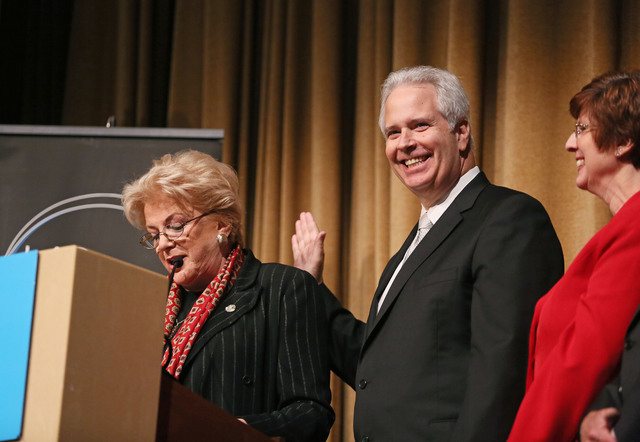 Bob Brown, center, is sworn in as Chairman of the Las Vegas Metro Chamber of Commerce by Las Vegas Mayor Carolyn Goodman, left, during the Las Vegas Metro Chamber Installation Luncheon at Aria hot ...