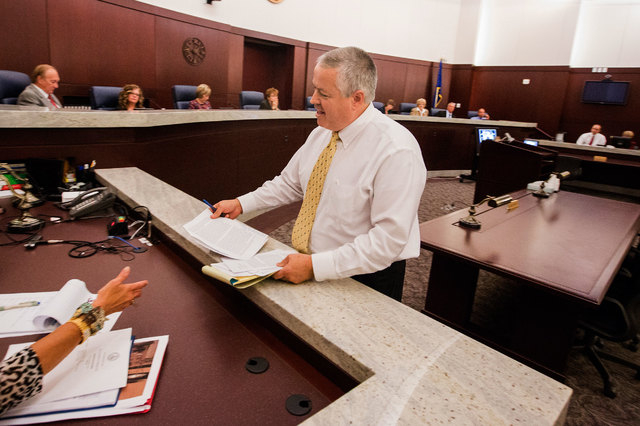 Foster parent Jamie Jackson provides written testimony for public record after speaking at Regional Justice Center on  Tuesday, Oct. 7, 2014. The committee discussed the shortcomings in Clark Coun ...