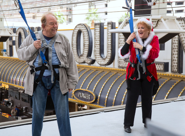Robin Leach and Las Vegas Mayor Carolyn Goodman react after riding SlotZilla at the Fremont Street Experience on Tuesday, Dec. 2, 2014.  (Samantha Clemens-Kerbs/Las Vegas Review-Journal)