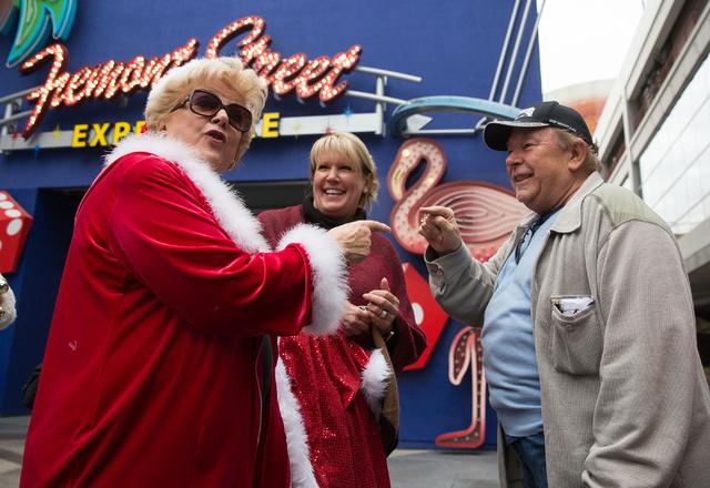 Las Vegas Mayor Carolyn Goodman, left, Dawn Newburg, center, and Robin Leach joke prior to riding SlotZilla at the Fremont Street Experience on Tuesday, Dec. 2, 2014.  (Samantha Clemens-Kerbs/Las  ...