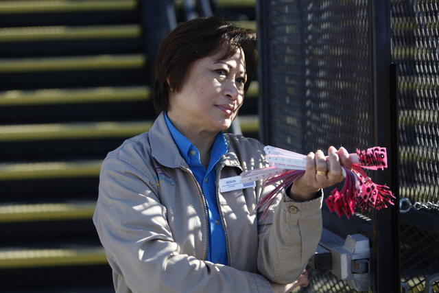Jocelyn Bautista, ride attendant at Circus Circus casino-hotel, waits to give out wristbands to children visiting Circus Circus Adventure Dome in Las Vegas Sunday, Dec. 14, 2014. Nearly 100 foster ...