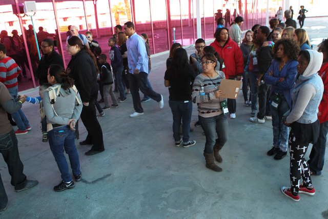 Children wait outside of Circus Circus Adventure Dome in Las Vegas for an event hosted by St. Jude's Ranch for Children Sunday, Dec. 14, 2014. Nearly 100 foster children separated from their sibli ...