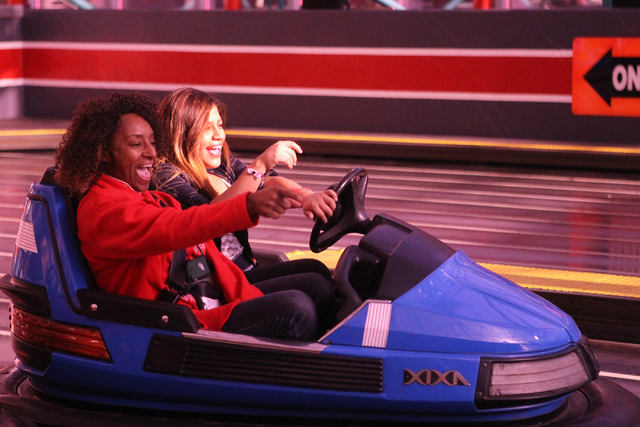 Volunteer with St. Jude's Ranch for Children Bridget Colson, left, rides a bumper car with Ana Aviles, 18, during a visit to Circus Circus Adventure Dome in Las Vegas for an event hosted by St. Ju ...