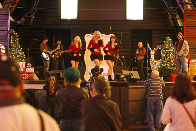 Performers entertain the crowd during the annual Fremont Street Experience's Christmas Tree Lighting event in Las Vegas Tuesday, Dec. 9, 2014. (Erik Verduzco/Las Vegas Review-Journal)