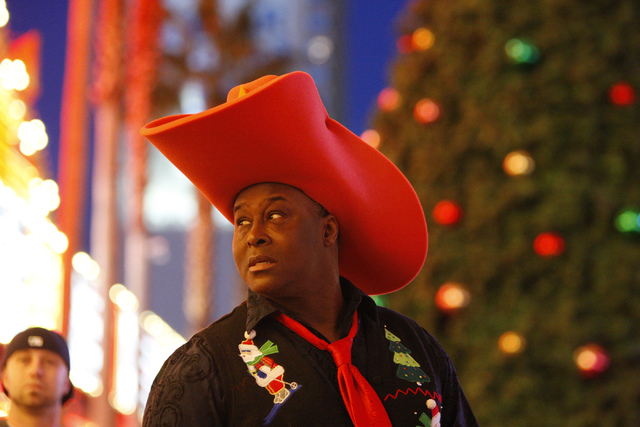 Larry Edwards waits during the annual Fremont Street Experience's Christmas Tree Lighting event in Las Vegas Tuesday, Dec. 9, 2014. (Erik Verduzco/Las Vegas Review-Journal)