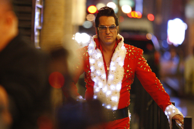 Jesse Garon, in costume as Santa Elvis, waits to take the stage during the annual Fremont Street Experience's Christmas Tree Lighting event in Las Vegas Tuesday, Dec. 9, 2014. (Erik Verduzco/Las V ...
