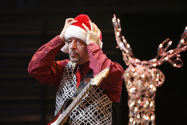 George Safire fixes his hat before performing on stage during the annual Fremont Street Experience's Christmas Tree Lighting event in Las Vegas Tuesday, Dec. 9, 2014. (Erik Verduzco/Las Vegas Revi ...