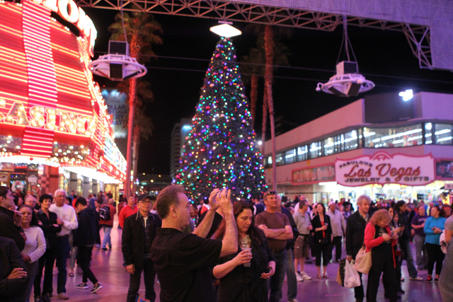 People take photos during the annual Fremont Street Experience's Christmas Tree Lighting event in Las Vegas Tuesday, Dec. 9, 2014. (Erik Verduzco/Las Vegas Review-Journal)