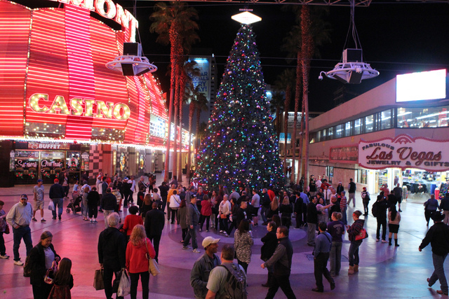 People gather during the annual Fremont Street Experience's Christmas Tree Lighting event in Las Vegas Tuesday, Dec. 9, 2014. (Erik Verduzco/Las Vegas Review-Journal)