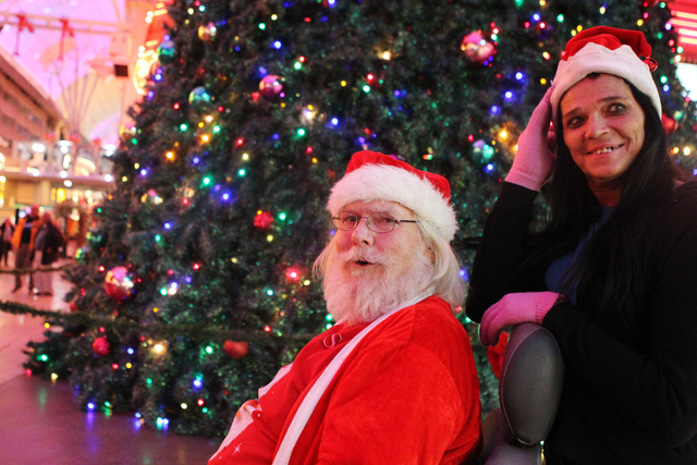 Ken Christopher, left, and his friend Fran Vitatoe, are photographed during the annual Fremont Street Experience's Christmas Tree Lighting event in Las Vegas Tuesday, Dec. 9, 2014. (Erik Verduzco/ ...