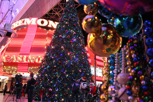 The 50-foot Christmas tree at the Fremont Street Experience is seen during annual Christmas Tree Lighting event in Las Vegas Tuesday, Dec. 9, 2014. (Erik Verduzco/Las Vegas Review-Journal)