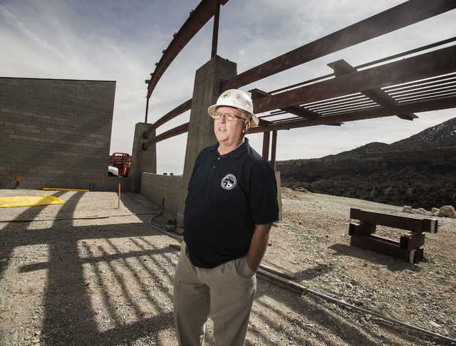 Steve Ririe, chairman of the Silent Heros of the Cold War Memorial, stands at the Spring Mountain Visitor Gateway under construction on the Kyle Canyon Road approaching Mount Charleston,Tuesday, F ...