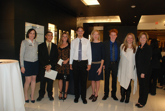 Winning students of the Write About An Adventure creative writing contest and their teachers were honored with a  reception at Montblanc Boutique at the Palazzo on Nov. 6. Smiling, from left, are  ...