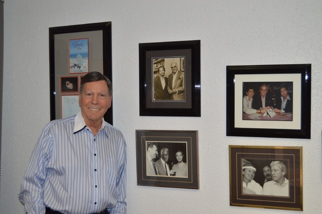 Bruce Merrin, CEO of Bruce Merrin Public Relations & Celebrity Speakers Entertainment, shows off his office collection of photos of clients including Ed McMahon, Jackie Robinson, and Merv Griffin. ...