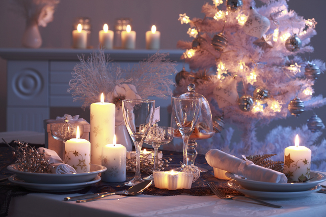 Thinkstock Flickering candles amid a white background provides a calming aura during a busy time of year.