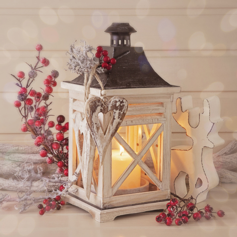 Thinkstock Sprigs of red holly berries complement the simple white lantern.