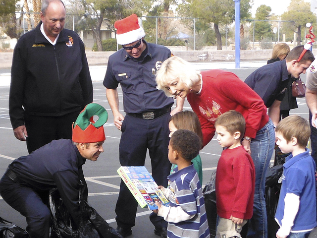 The Firefighters of Southern Nevada Burn Foundation delivers toys Dec. 19, 2013, to students at Gray Elementary School, 2825 S. Torrey Pines Drive. The toys were donated during the foundation's an ...