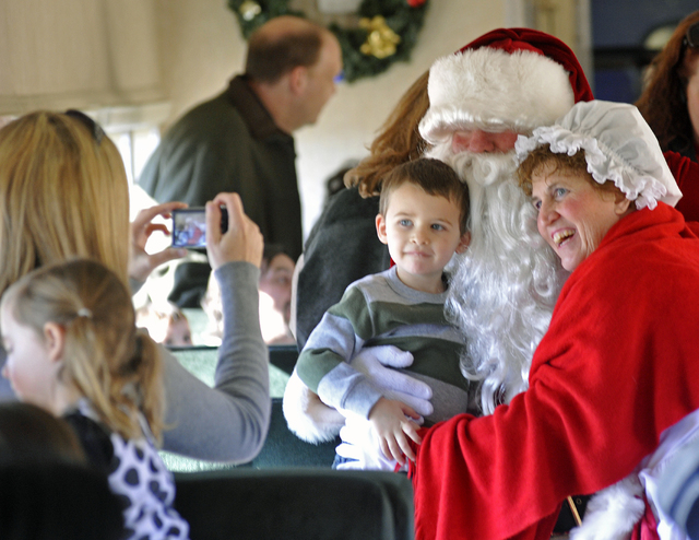 Boulder City Review File Photo Three year old Las Vegan, Talon Gustafson poses, as his mother, Leah takes a picture of him with Santa and Mrs Claus while riding the Santa Train in Boulder City,Sun ...