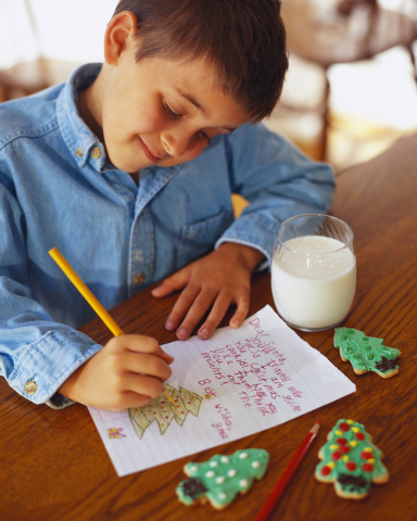 Courtesy photo Boy Writing Letter   A variety of crafts and activities, including making holiday cards for soldiers, are available at today's free Hometown Holidays event from 4 p.m. to 8 p.m. a ...