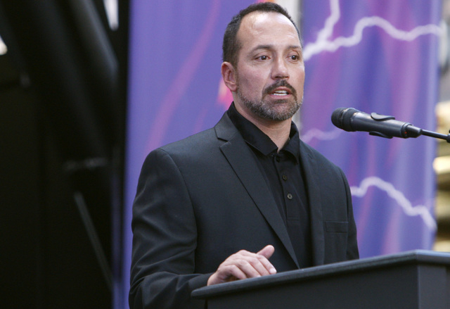 Coach Aaron Garcia speaks during an event to officially announce Las Vegas' new Arena Football League team, the Las Vegas Outlaws, Thursday, Sept. 25, 2014 at the Fremont Street Experience. (Sam M ...