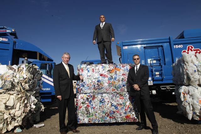 Republic Services employees from left, Bob Coyle, vice president of government affairs, Len Christopher, general manager of the recycling division, and Tim Oudman, area president, pose for a portr ...