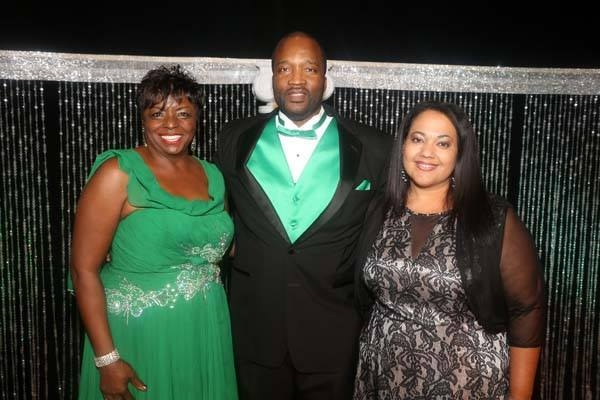 Officers of the Urban Chamber of Commerce show some green at the groups awards event. From left are Jerrie E. Merritt, UCC chair; Kenneth Evans, UCC president, and Summer Rabb, UCC manager.