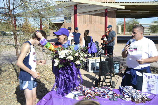 Ken Kerby, vice president of the Henderson Police Officers' Association, and Julie Proctor, executive director of S.A.F.E. House, host the annual Run for Shelter 5K and 1 Mile Run, Walk or Strol ...