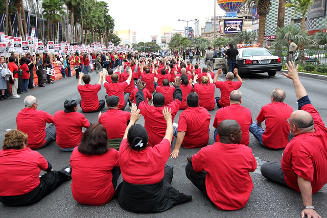 In an act of civil disobedience, members of the Culinary Union block traffic on the Strip in front of The Cosmopolitan hotel-casino during a planned protest in Las Vegas, March 20, 2013. (Jason Be ...