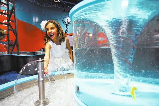 """Tessa Maddox plays in the """"Water World"""" exhibit inside the new Discovery Children's Museum, March 1, 2013. The Discovery Children's Museum is teaming up with the Las Vegas-Clark County Library D ..."""