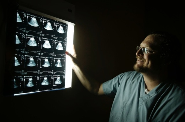 Dr. Michael Finkelstein of Urology Specialists of Nevada reviews ultrasound images. His company is one of three big urology practices vying for supremacy in Southern Nevada. (Courtesy)