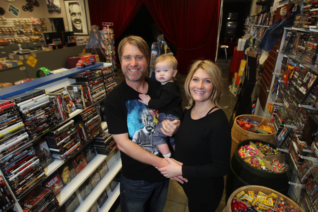 Trevor Layne, left, and his wife Katie, owners of Movies & Candy, 10895 S. Eastern Ave., pose for a portrait with their son Hudson, 1, inside their shop in Henderson Tuesday, Dec. 9, 2014. The mov ...
