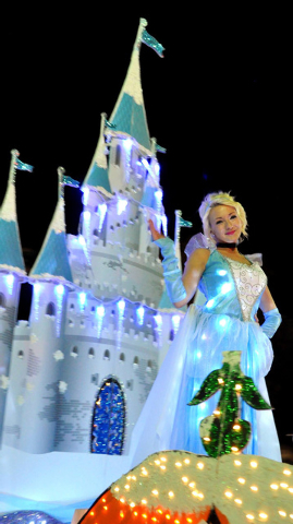 """""""Cinderella"""" waves to her fans during the 2014 Henderson WinterFest Parade Dec. 13. (Special to View)"""