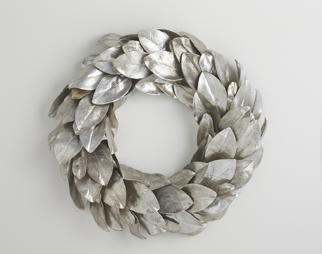 Courtesy Crate and Barrel Silvery magnolia leaves create an elegant, textural holiday wreath that transcends decor styles.